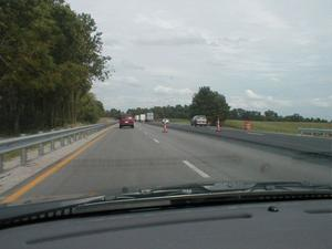 Northbound on I-65. A final layer of asphalt is being added. (August 15, 2002)