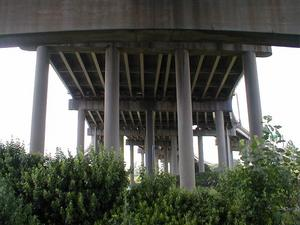 Ramps splitting from and joining to I-65 underneath the Kennedy Bridge at the I-64-I-65-I-71 Spaghetti Junction interchange.