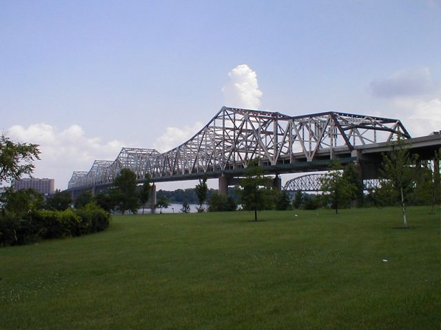 "The I-65 John F. Kennedy Bridge over the Ohio River at Louisville viewed from Louisville's Waterfront Park. The bridge in the background is the ""Big Four"" railroad bridge."