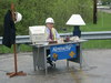 [Transportation Cabinet official Tim Henderlight set up a desk in a highway work zone in Breathitt County Friday to make his point as he discussed the need for driving safely in construction zones.]