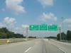 Northbound on Gene Snyder Freeway at Exit 35 for I-71. I-265 ends here; KY 841 continues north. (July 6, 2003)