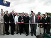 Kentucky Gov. Patton and Indiana Gov. O'Bannon cut a ribbon marking the official dedication of the bridge.