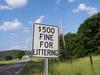 Regulatory sign denoting fine for littering.